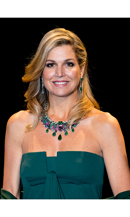 Queen Maxima of the Netherlands rocked a bronzed look that set off her gorgeous jewels as she attended a concert in The Hague. 