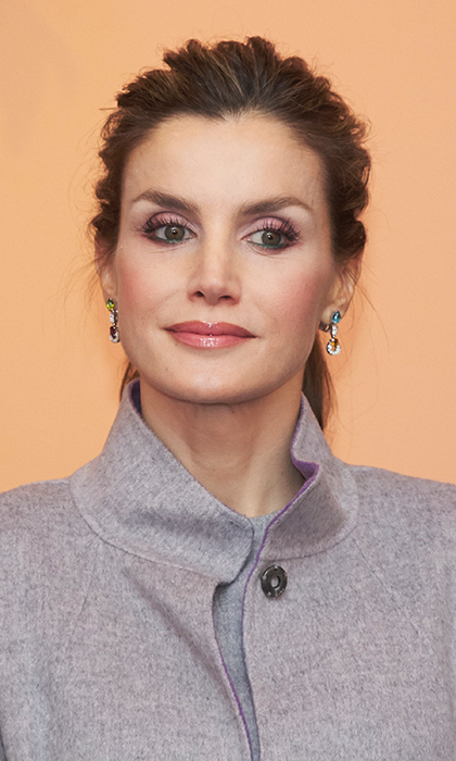 Queen Letizia of Spain wore pink hues and a glossy lip at a reception held at the Spanish Embassy in Lisbon, Portugal.