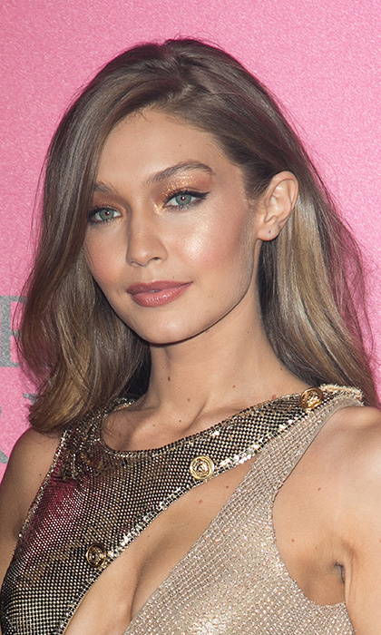 Victoria's Secret Angel Gigi Hadid was a glittering goddess to match her metallic dress at the lingerie brand's fashion show after party at Le Grand Palais in Paris, France. 