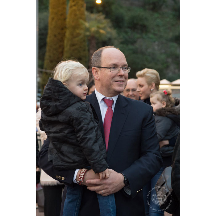 Prince Albert held on to his son as they took in the holiday sights.