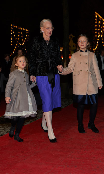Queen Margrethe held on to her granddaughters, Princess Josephine and Princess Isabella's hands as they made their way into the concert hall.