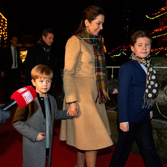 Stylishly dressed Crown Princess Mary stayed close to her sons Prince Vincent and Prince Christian at the ballet premiere.