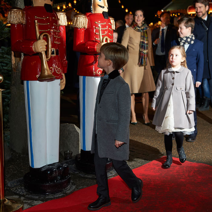The Danish siblings took in the holiday decorations, which included nutcracker statues.