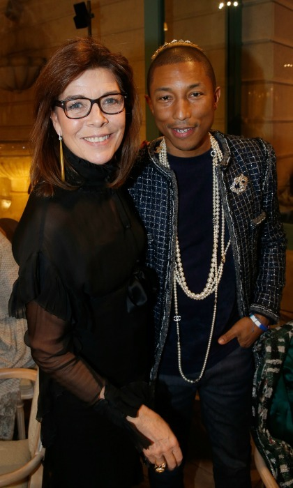 Pharrell Williams was happy to meet Princess Caroline of Monaco during the Chanel Metiers d'Art Show in Paris. 
