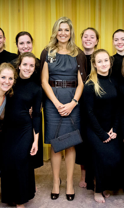 Queen Maxima showed off her style credentials wearing a Natan dress with a cardigan draped over her shoulders for her visit to the De Pracht community center.