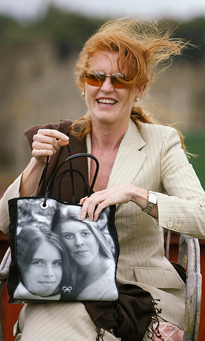 Prince Andrew's ex-wife kept her daughters close to her, while out at the Cowdray Park Polo Club in 2003, carrying a tote sporting Eugenie and Beatrice's faces. 