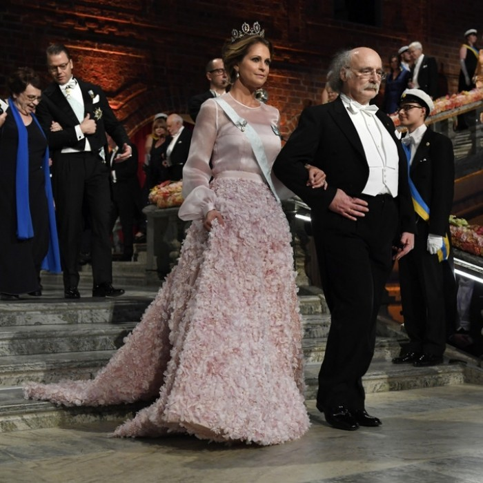 "Princess Madeleine escorted Nobel Physics laureate Fraser Stoddart in to City Hall. The mother-of-two chose a blush gown to complement her Connaught ""forget me not"" tiara.