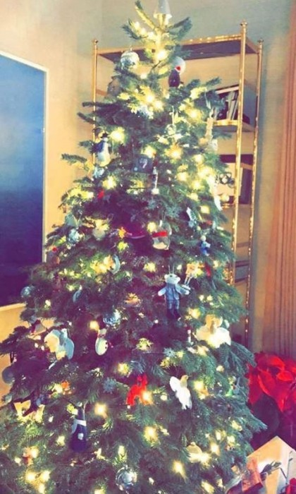 Reese Witherspoon took to Instagram to ask her followers for the best tree-trimming tips. The Draper James founder showed off her family's tree that already has some presents waiting below.