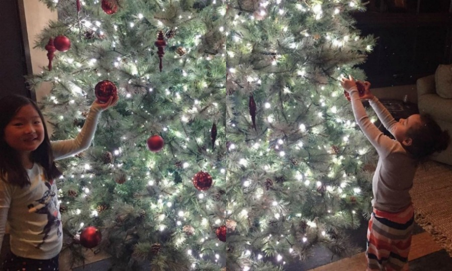 Josh Kelley showed his and Katherine Heigl's daughters decorating their Christmas tree in two separate photos. Naleigh and Adalaide wore their pajamas while adding ornaments to the lit up tree.