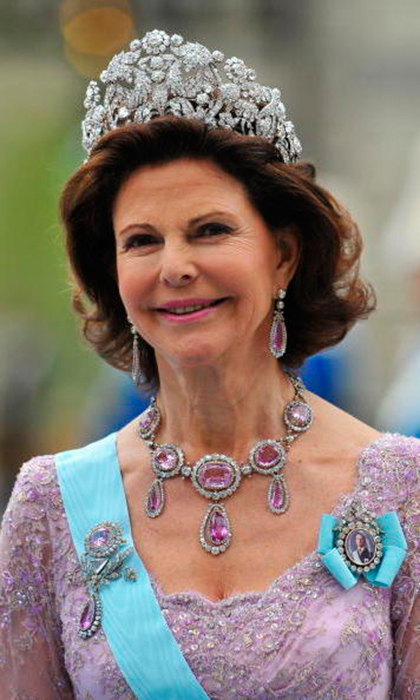 Queen Silvia favors the larger tiaras – this one is known as the Bragança, which is nearly five inches tall. It is a heritage piece, passed down many generations from Queen Josephine's sister Empress Amélie of Brazil.