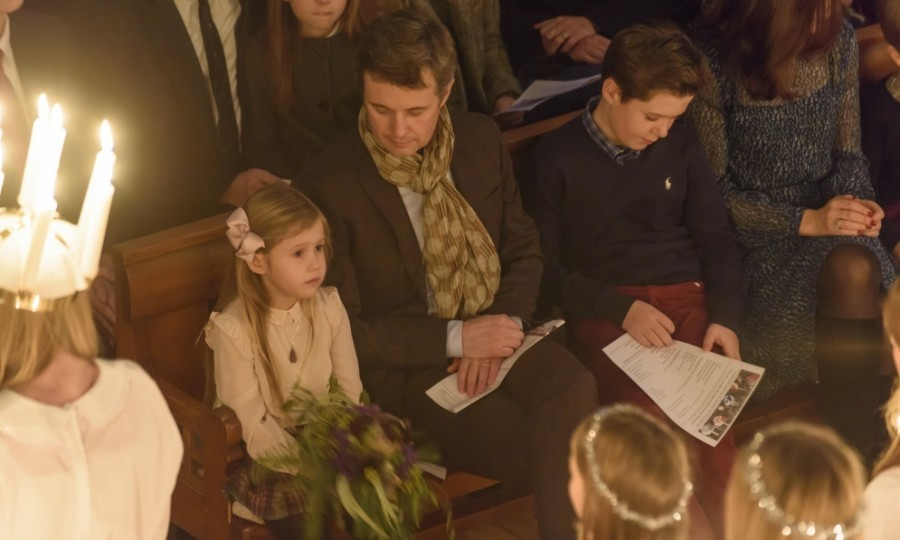 Watching intently, Princess Josephine sat next to her father Crown Prince Frederik while still holding on to her flowers.