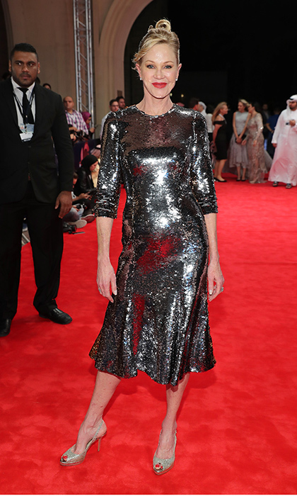 "<a href=""http://us.hellomagazine.com/tags/1/melanie-griffith/""><strong>Melanie Griffith</strong></a> turned heads in a molten metal-look midi dress on the <I>Solitaire</I> red carpet at the 13th annual Dubai International Film Festival on December 11, 2016. 