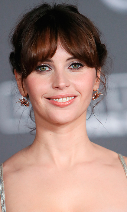 Felicity Jones looked like an English rose with her dewy makeup and soft bangs at the premiere of Walt Disney Pictures and Lucasfilm's <I>Rogue One: A Star Wars Story</I> at the Pantages Theatre in Hollywood on December 10.