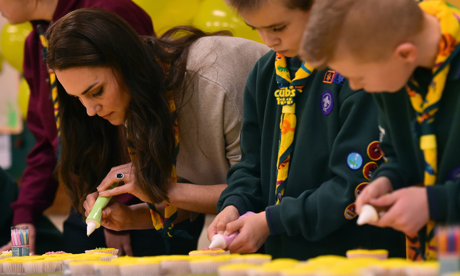 "Kate tried her hand initially icing cupcakes with pink icing. ""Who wants the pink...No one... its me then,"" she said as she tried to create a Cub 100 decoration on the cupcake.