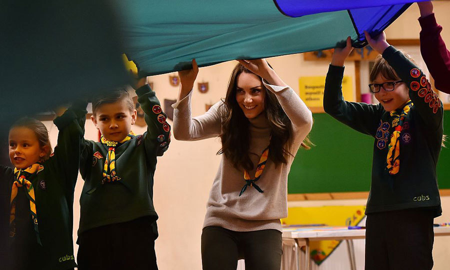 Peek-a-boo, we see you! The mom-of-two participated in a parachute game, keeping a ball aloft and ran under to another position during a session in which birthday months were shouted. Kate, whose birthday is in January, was one of the last ones to run!