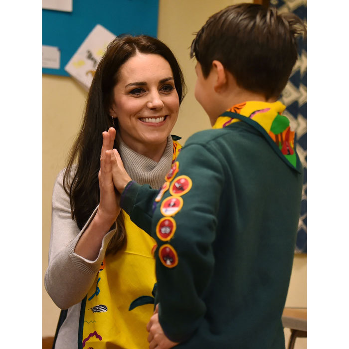 "Kate gave a high five to Dylan McKenna for successfully putting her arm in a sling with the special Cubs 100 scarf. ""She said I did a good job,"" the nine-year-old revealed of his encounter with the Duchess. ""She said 'Well done I'm very impressed with this.'""