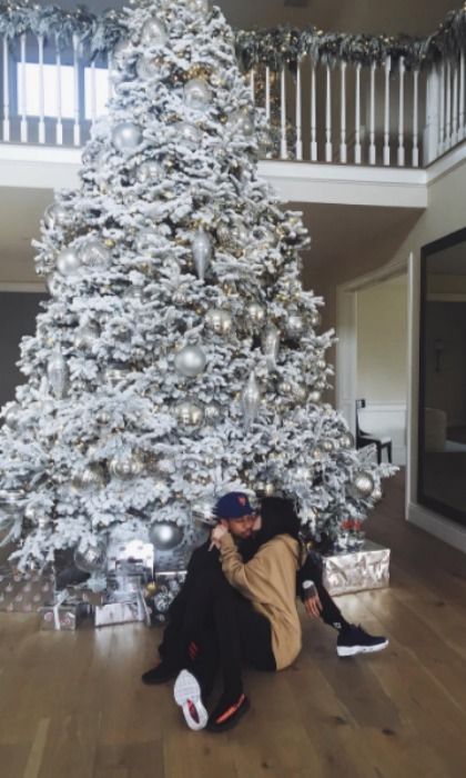 "Kylie Jenner and her boyfriend Tyga got in some pre-holiday kisses by the tree. The makeup maven captioned the pic, ""All I want for Christmas is you."" 