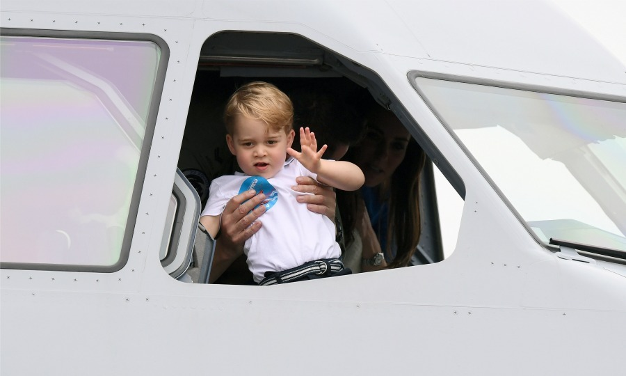 Like any royal in training, George was lifted up by his mom to give the crowd a friendly wave while he was inside the cockpit of a plane. 