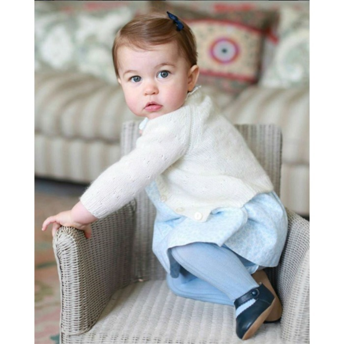 "Charlotte showed off her little royal lady fashion in a sky blue dress and Early Days ""Emma"" shoes and a little bow. 
