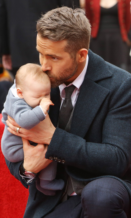 The doting dad placed a gentle kiss on his and Blake Lively's newborn daughter's head during his Hollywood Walk of Fame ceremony.