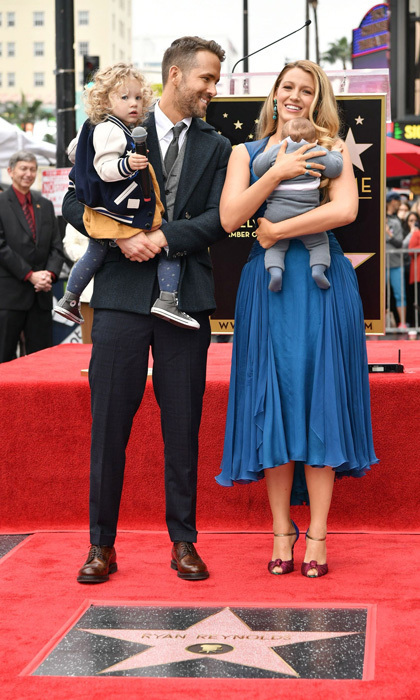 Ryan Reynolds beamed alongside his wife Blake Lively and their daughters at his Hollywood Walk of Fame ceremony.