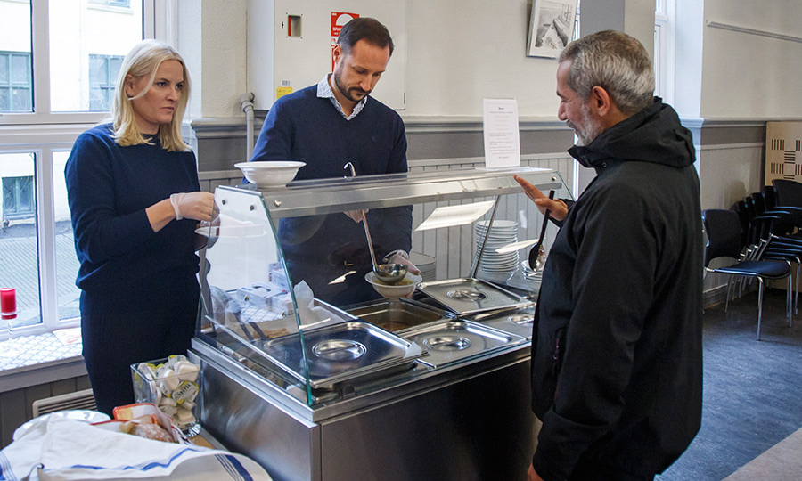 Crown Prince Haakon and Crown Princess Mette-Marit showed the spirit of giving as they helped feed the poor during their visit to the project ByFrokost at the Church City Mission in Oslo.