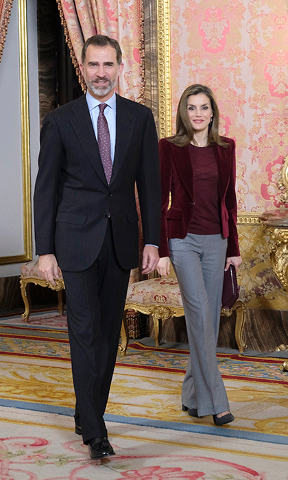 King Felipe VI of Spain and Queen Letizia were stylish in suits at the Royal Palace in Madrid on December 14. 