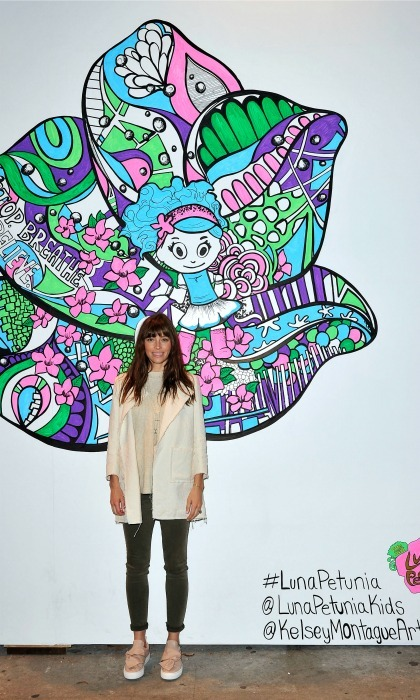 "December 14: Getting artsy! <a href=""http://us.hellomagazine.com/tags/1/jessica-biel/""><strong>Jessica Biel</strong></a> stopped by her restaurant Au Fudge in L.A. and snagged a photo in front of the mural inspired by the new Netflix kids series <i>Luna Petunia</i>. 