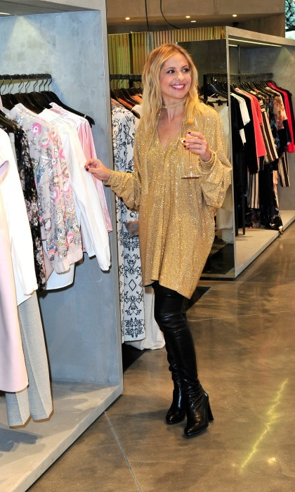 December 14:  Sarah Michelle Gellar enjoyed Sauvignon Blanc from Kim Crawford wines limited-edition holiday bottle during a shopping event at CURVE in Culver City. 