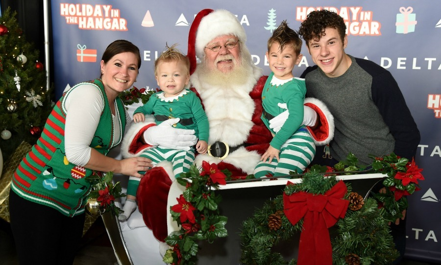 December 13: Nolan Gould and Santa posed with guests as they surprised 150 children from Children's Hospital Los Angeles and P.S. ARTS,  at Delta Air Lines' sixth annual Holiday in the Hangar Celebration in L.A. 