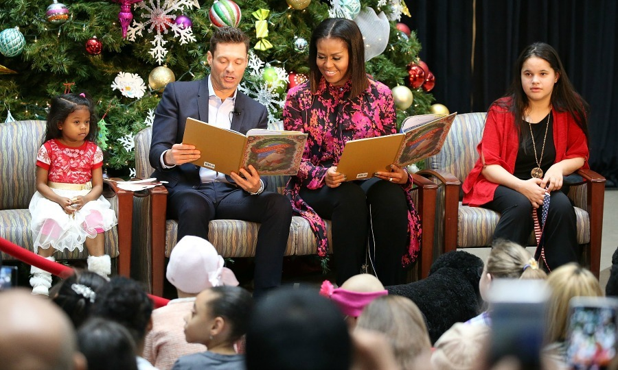 December 12: 'Tis the season! Michelle Obama and Ryan Seacrest read to some lucky kids during a visit to the Children's National Health System in Washington, D.C. 