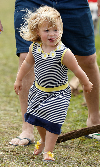 Queen Elizabeth's great granddaughter Mia Tindall was truly adorable in this striped daisy embroidered dress for a day out at England's Gatcombe Park in August 2016.