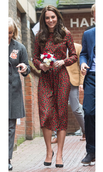 With less than a week until Christmas, the Duchess showed off her holiday spirit donning a festive red and green floral-print jacquard dress by Vanessa Seward. Kate accessorized the look for the Heads Together Christmas party with a McQueen glossed-leather belt and black suede Gianvito Rossi pumps.