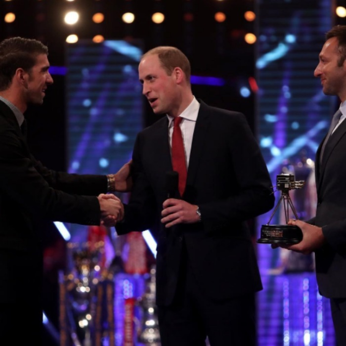 Prince William and Team USA swimmer Michael Phelps had an Olympic-themed introduction during the BBC Sports Personality of the Year ceremony. The Prince presented the historic Olympian with the Lifetime Achievement Award. 
