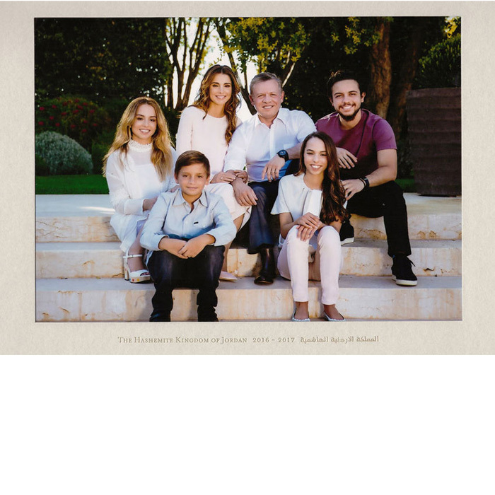 King Abdullah II and Queen Rania of Jordan were joined by their four children - Princess Iman, Prince Hashem, Princess Salma and Crown Prince Hussein - for their 2016-2017 New Year card, which showed the royals dressed down in everyday wear for the sweet family portrait taken on the steps of the palace of Amman.