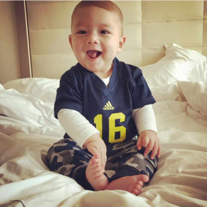 "Destined for sports! Boomer rocked his number 16 Michigan jersey to cheer on the ""Blue!!!""