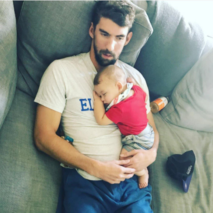 Michael held his baby boy close as Boomer napped peacefully on his father's chest.