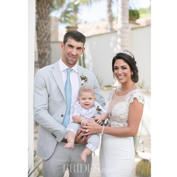 "Boomer made one cute wedding party member! Michael Phelps' young son served as the adorable ring bearer at his parents's second nuptial in Cabo San Lucas, Mexico back in October. Discussing her son's role on her special day, Nicole Johnson told <a href=""http://www.brides.com/story/michael-phelps-wedding-video"">Brides magazine</a>, ""We put [the ring] in one of those little net bags that you have for jewelry. We got one that matched his [Burberry] outfit, and we put that around his wrist, and he was carried down the aisle by [friend and gold-medal swimmer] Allison [Schmitt], our roommate. I think he kind of sucked on the bag a little bit while he was standing up there!""