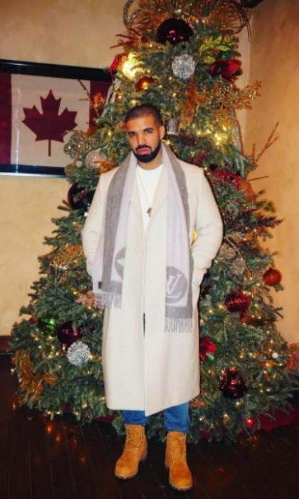 Drake added some handsome to his holiday as he stood bundled up next to a tall Christmas tree. 