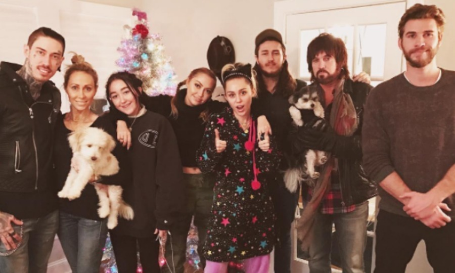 "A very <i>Cyrus</i> Christmas! Liam Hemsworth celebrated the holidays early with girlfriend Miley Cyrus and her family. The group (from left to right: Trace, Tish, Noah, Brandi, Miley, Braison, Billy Ray and Liam) posed for the family portrait in front of a colorful Christmas tree. Attached to the picture, Brandi Cyrus wrote, ""Cyrus fam Christmas in full swing."" 