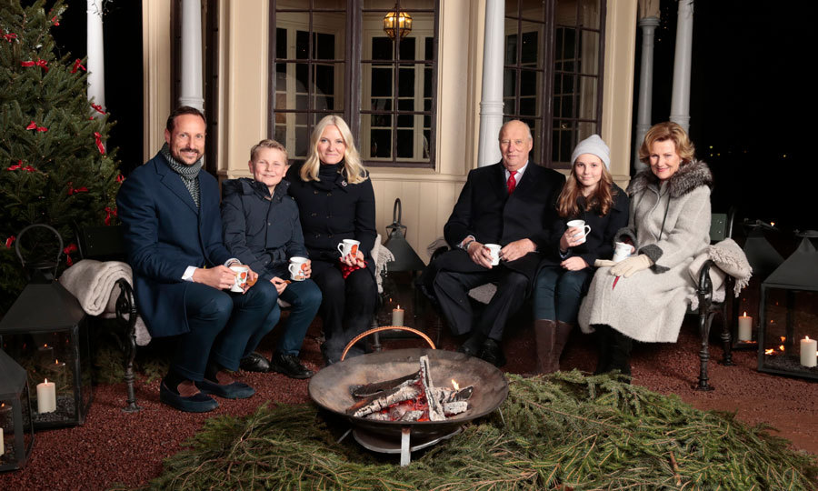 Norway's royal family (Crown Prince Haakon, Prince Sverre Magnus, Crown Princess Mette-Marit, King Harald, Princess Ingrid Alexandra and Queen Sonja) gathered for a Christmas photo complete with mulled wine and gingerbread at the garden of the royal palace in Oslo.