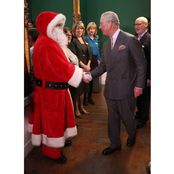 Put it there! Prince Charles gave Santa Claus a handshake during his surprise appearance at the Dumfries House Tea Dance held at Dumfries House in Cumnock, Scotland.
