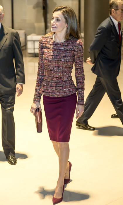 Queen Letizia looked business chic wearing a bouclé peplum top paired with a Hugo Boss pencil skirt to attend a meeting with the Foundation Against Drug Addiction in Madrid. 