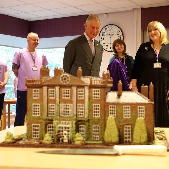 Prince Charles donated a cake replica of his Highgrove estate during his visit to the Ayrshire Hospice in Ayr, where he met patients and their families, in addition to staff and volunteers. 