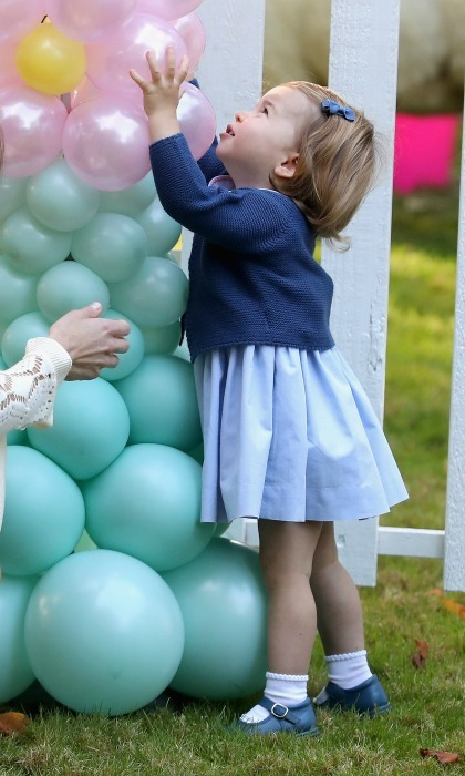 "Charlotte couldn't get enough of the balloons! The little Princess rushed over to the massive balloon display and gave it a big hug as she said ""pop.""