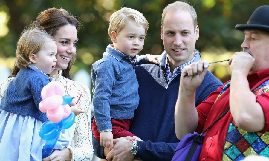 The royal tots were enamored by the balloons as they held on to their parents. 