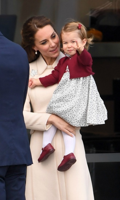Charlotte stepped out of the car in style, as she held on to her mother before making her way into the sea plane. 