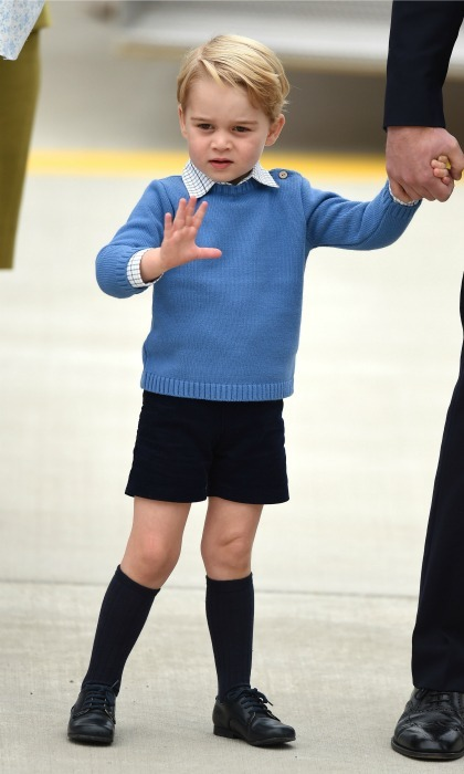 George waved to royal watchers as she stepped off of the plane holding on to his father's hand. 