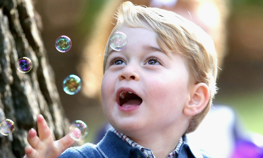 Break out the bubbles! In one of his cutest moments to date, George was all smiles as he played with bubbles. The future king even tried to get little Charlotte in on the fun, blowing bubbles in her direction as she smiled. 