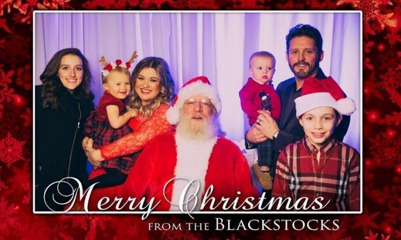 Kelly Clarkson wished her fans a Merry Christmas with a festive card featuring her and Brandon's two kids as well as his children.